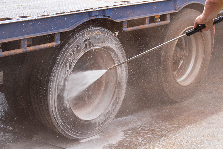 High Pressure Cleaning a Trucks Wheel.
