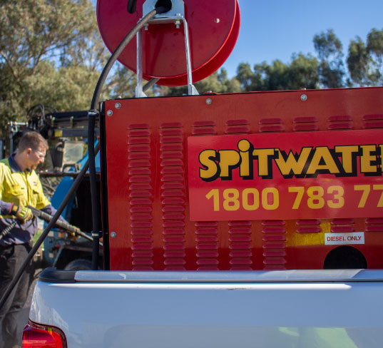 Pressure Cleaning with a Spitwater Hot Water Diesel on a Ute
