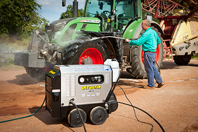 High Pressure Cleaning a Tractor for Agriculture.