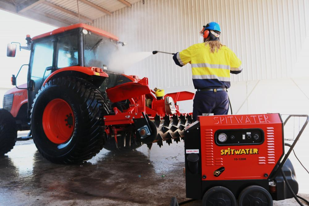 Cleaning down a Tractor with a Hot Water Spitwater Pressure Cleaner