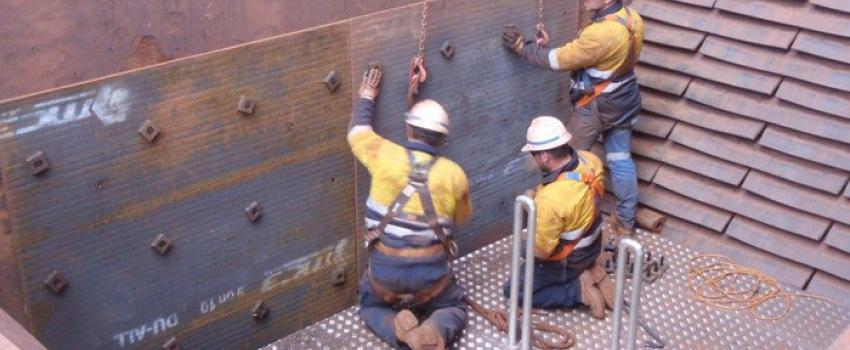 workers on a custom platform in a chute
