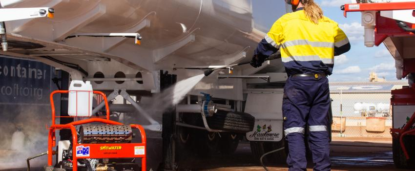 Pressure cleaning a truck with a Spitwater pressure cleaner in the red dirt