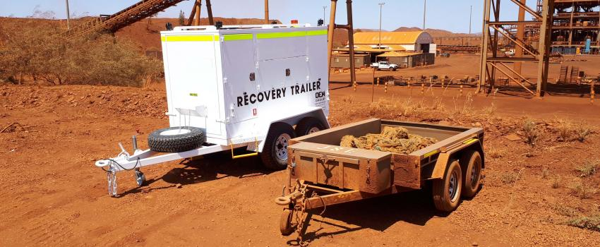 OEM Group's Recovery trailer next to an old trailer holding the rope on a minesite.