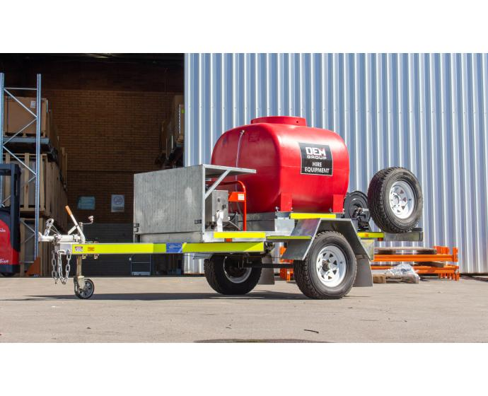TSA-15210DEM High Pressure Cleaning Trailer Single Axle in front of Warehouse