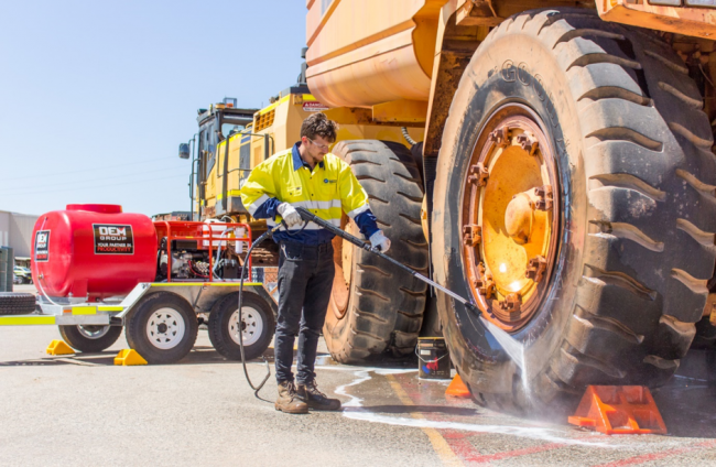 Cleaning Mining Truck Tyres with Diesel Pressure Cleaner Mounted Trailer