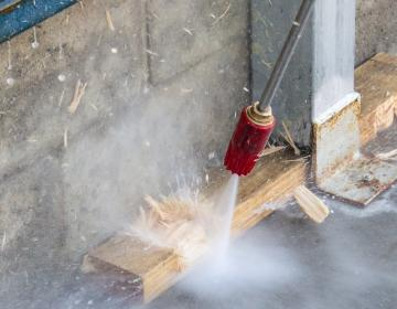 high pressure cleaner nozzle blasting though wood
