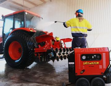 high pressure cleaning a tractor